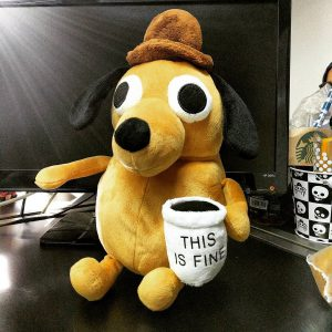"""The """"this is fine"""" dog as a stuffed animal"""